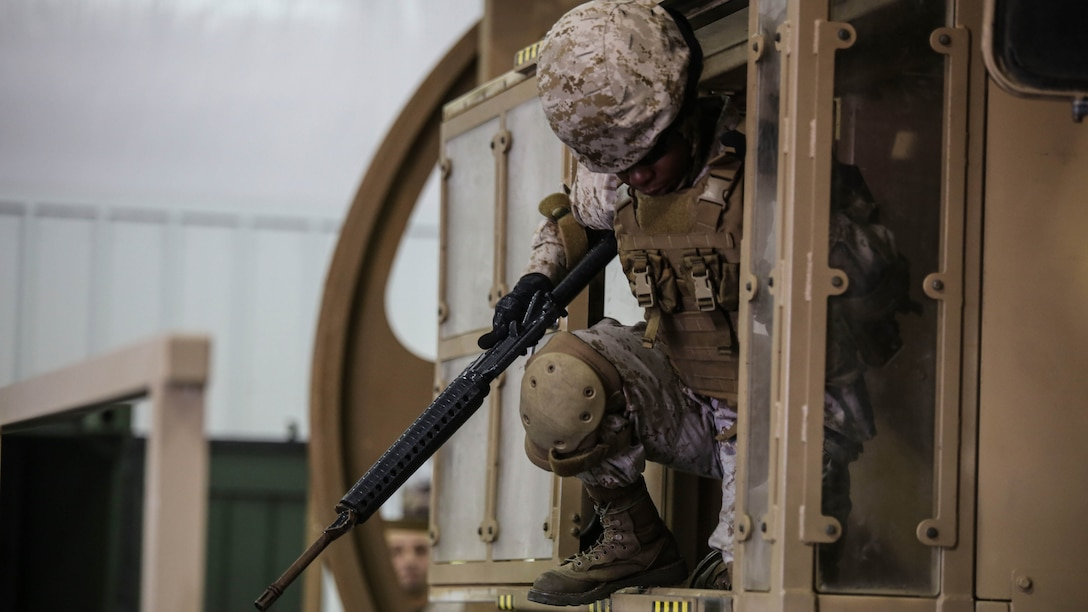 A Marine with 2nd Supply Battalion, Combat Logistics Regiment 25, exits a simulator at Marine Corps Base Camp Lejeune, North Carolina, Sept. 23, 2015. The battalion conducted the training to remain proficient in potentially life-saving skills as they prepare to deploy around the globe.