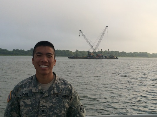 ROTC Cadet Justin Wynne on a survey boat before the CSS Georgia recovery station.