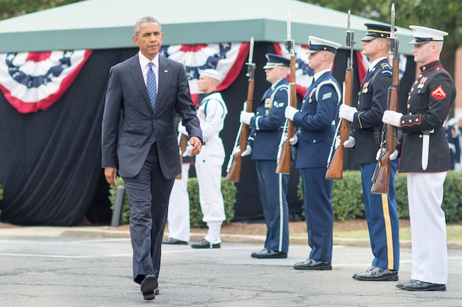 President Barack Obama attends the chairman change of responsibility ceremony on Joint Base Myer-Henderson Hall in Arlington, Va., Sept. 25, 2015. During the ceremony, Army Gen. Martin E. Dempsey, outgoing chairman of the Joint Chiefs of Staff, retired from the military after 41 years of service and was succeeded as chairman by Marine Corps Gen. Joseph F. Dunford Jr. DoD photo by D. Myles Cullen