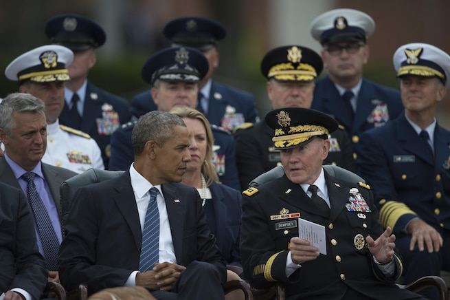 President Barack Obama talks with Army Gen. Martin E. Dempsey, outgoing chairman of the Joint Chiefs of Staff, during a ceremony for Dempsey's retirement and the chairman of the Joint Chiefs of Staff change of responsibility ceremony on Joint Base Myer-Henderson Hall in Arlington, Va., Sept. 25, 2015. DoD photo by Petty Officer 2nd Class Dominique A. Pineiro