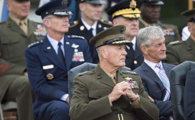 Marine Corps Gen. Joseph F. Dunford Jr., incoming chairman of the Joint Chiefs of Staff, listens to remarks from the outgoing chairman, Army Gen. Martin E. Dempsey, during a retirement and change of responsibility ceremony on Joint Base Myer-Henderson Hall in Arlington, Va., Sept. 25, 2015. DoD photo by Petty Officer 2nd Class Dominique A. Pineiro