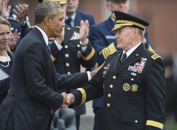 President Barack Obama, left, greets Army Gen. Martin E. Dempsey, outgoing chairman of the Joint Chiefs of Staff, during a retirement and change of responsibility ceremony on Joint Base Myer-Henderson Hall in Arlington, Va., Sept. 25, 2015. DoD photo by Petty Officer 2nd Class Dominique A. Pineiro
