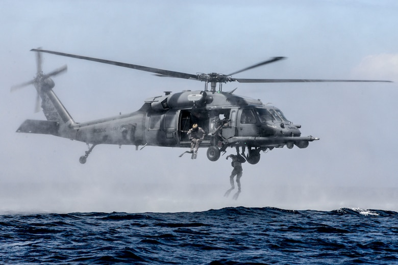 Airmen from the 320th Special Tactics Squadron at Kadena Air Base, Japan, perform a helo-casting jump out of an HH-60G Pave Hawk from the 33rd Rescue Squadron during an amphibious operations exercise Sept. 22, 2015, off the west coast of Okinawa, Japan. Team members are qualified in nonstandard methods of infiltration,  including static line, military free fall, and closed and open circuit diving. (U.S. Air Force photo/Senior Airman John Linzmeier)