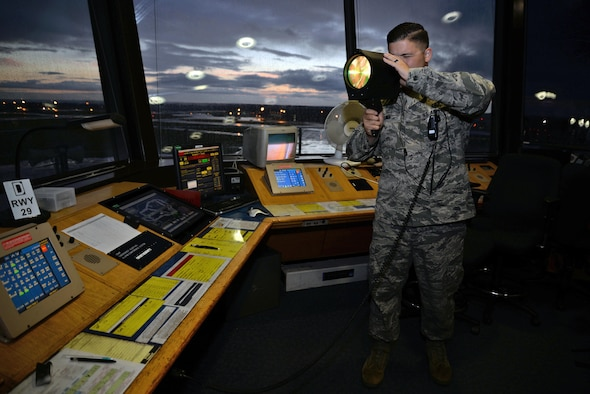 Senior Airman Drew Kalina, a 100th Operations Support Squadron air traffic controller, demonstrates how to use a light gun in the air traffic control tower Sept. 21, 2015, on Royal Air Force Mildenhall, England. A light gun is used when there is no way of communicating with pilots via radio. (U.S. Air Force photo/Senior Airman Christine Halan)