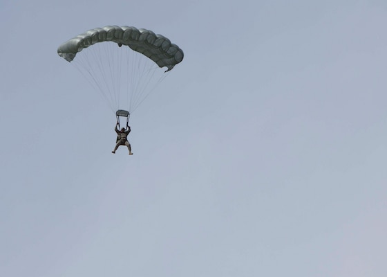 Army Staff Sgt. Jay Media, operations non-commissioned officer in charge, parachutes to the ground during a free fall jump on April 14.