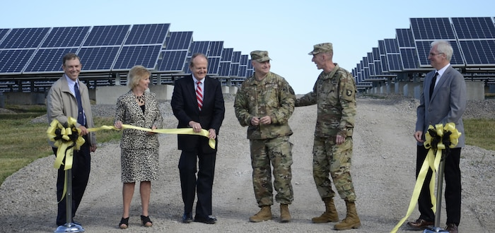 """Jim Duttweiler, Directorate of Public Works, Sandy Grogan, Pennyrile Rural Electric Cooperative, John Davies, Kentucky Department for Energy Development and Independence, and Rick McCoy, DPW, join Garrison Commander Col. James """"Rob"""" Salome and Maj. Gen. Gary J. Volesky, 101st Airborne Division and Fort Campbell commander, for the ribbon-cutting for Phase One of the installation's solar array."""