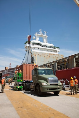 Stevedores assist with loading a container onto the Ocean Giant.