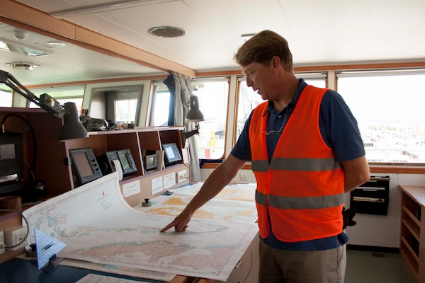 Capt. Matthew Craven shows the route the Ocean Giant will take on its 11 day voyage to Thule Air Force Base.