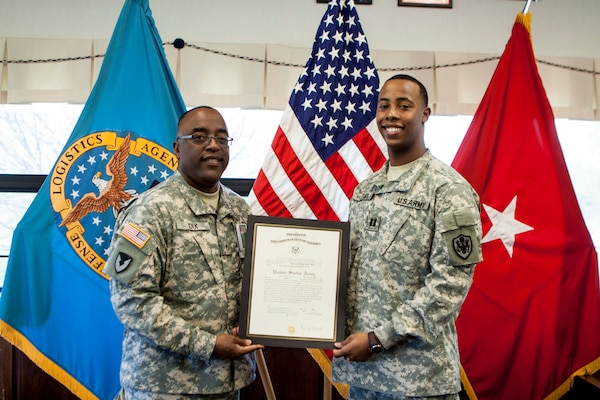 Army 1st Lt. Domonick Sylve, aide-de-camp to the Defense Logistics Agency Distribution commander, pinned on the rank of captain in a ceremony on May 1.