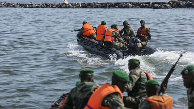 Compagnie Fusilier de Marin Commandos depart after raiding a simulated enemy position during the final exercise with U.S. service members in Dakar, Senegal, Sept. 17, 2015. The Marines and Coast Guardsmen with Special-Purpose Marine Air-Ground Task Force Crisis Response-Africa spent four weeks training the COFUMACO on basic infantry tactics and small-boat operations as a part of a Maritime Security Force Assistance mission to increase interoperability with Senegal's and strengthen the bond between the partner nations.