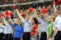 Airmen and senior leaders wave their hats to the crowd at Nationals Park in Washington, D.C., Sept. 18, 2015. The Washington Nationals team members and fans saluted members of the Air Force. (Air Force photo/Staff Sgt. Whitney Stanfield)