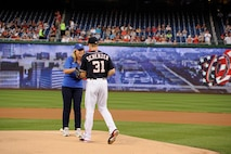 Secretary of the Air Force Deborah Lee James passes the game ball to Max Scherzer at Nationals Park in Washington, D.C., Sept. 18, 2015. Scherzer is a pitcher on the Washington Nationals baseball team. (Air Force photo/Staff Sgt. Whitney Stanfield)
