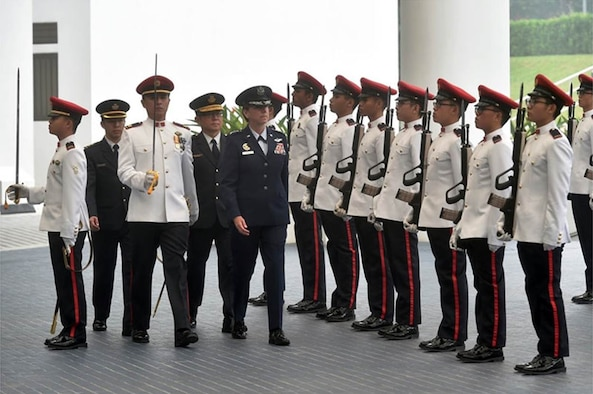 U.S. Air Force Gen. Lori J. Robinson, Pacific Air Forces commander, inspects the Guard of Honour at the Ministry of Defence in Singapore Sept. 28, 2015. The inspection was part of Robinson's introductory visit to Singapore from Sept. 27-30, 2015, in which she will visit the Changi Command and Control Centre at Sembawang Air Base, Singapore, and speak to students at the Goh Keng Swee Command and Staff College. The visit highlights the partnership between the two countries, as well as enhancing the interoperability and professionalism between the two air forces. (Singapore Ministry of Defence photo/Released)