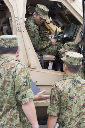 Japan Ground Self-Defense Force members take a look inside a mine-resistant ambush-protected all-terrain vehicle during an English seminar at Marine Corps Air Station Iwakuni, Japan, Sept. 15, 2015. Members of the JGSDF received several English classes, physically trained with Marines and toured the installation during the two-day English seminar. The seminar helped the JGSDF members understand commonly used English idioms and gave them a look at the day to day operations of the air station.