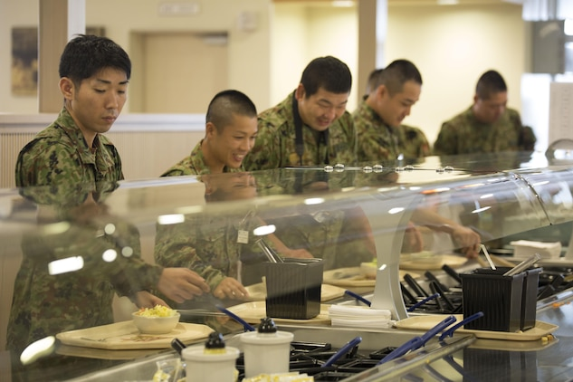 Japan Ground Self-Defense Force members joined Marines for lunch at the R.G. Robinson Mess Hall at Marine Corps Air Station Iwakuni, Japan, Sept. 15, 2015. Members of the JGSDF visited MCAS Iwakuni for an English seminar helping them to better communicate with American military members and build a greater positive relationship between the Japanese and Americans.