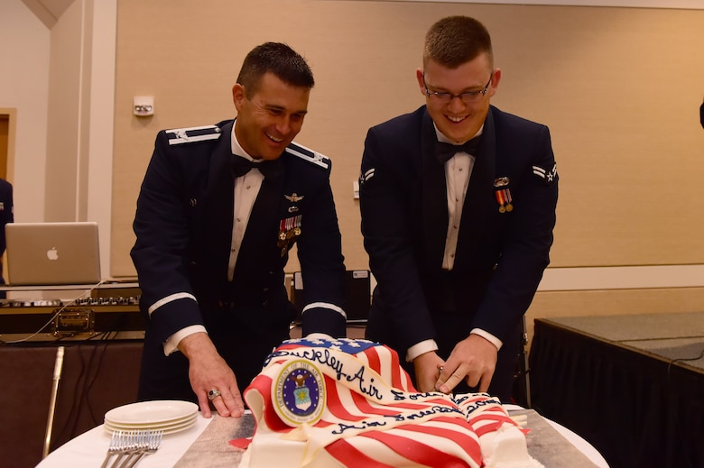 Col. John Wagner, 460th Space Wing commander and Airman 1st Class Don Cox, Force Support Squadron customer support technician, cut the cake at the Air Force Ball Sept. 25, 2015, at the Westin Hotel in Denver. Team Buckley held an annual ball to celebrate the 68th birthday of the Air Force. (U.S. Air Force photo by Airman 1st Class Luke W. Nowakowski/Released)