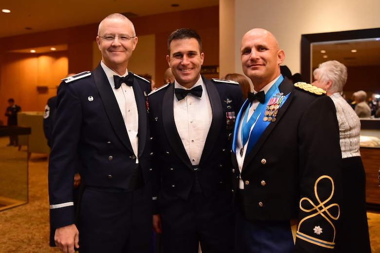 From left, Col. Michael Kindt, 460th Space Wing Medical Group commander, Col. John Wagner, 460th Space Wing commander and Lt. Col. Andrew Pekala, 743rd Military Intelligence Battalion commander, stand together during the Air Force ball Sept. 25, 2015, at the Westin Hotel in Denver. Team Buckley held an annual ball to celebrate the 68th birthday of the Air Force. (U.S. Air Force photo by Airman 1st Class Luke W. Nowakowski/Released)