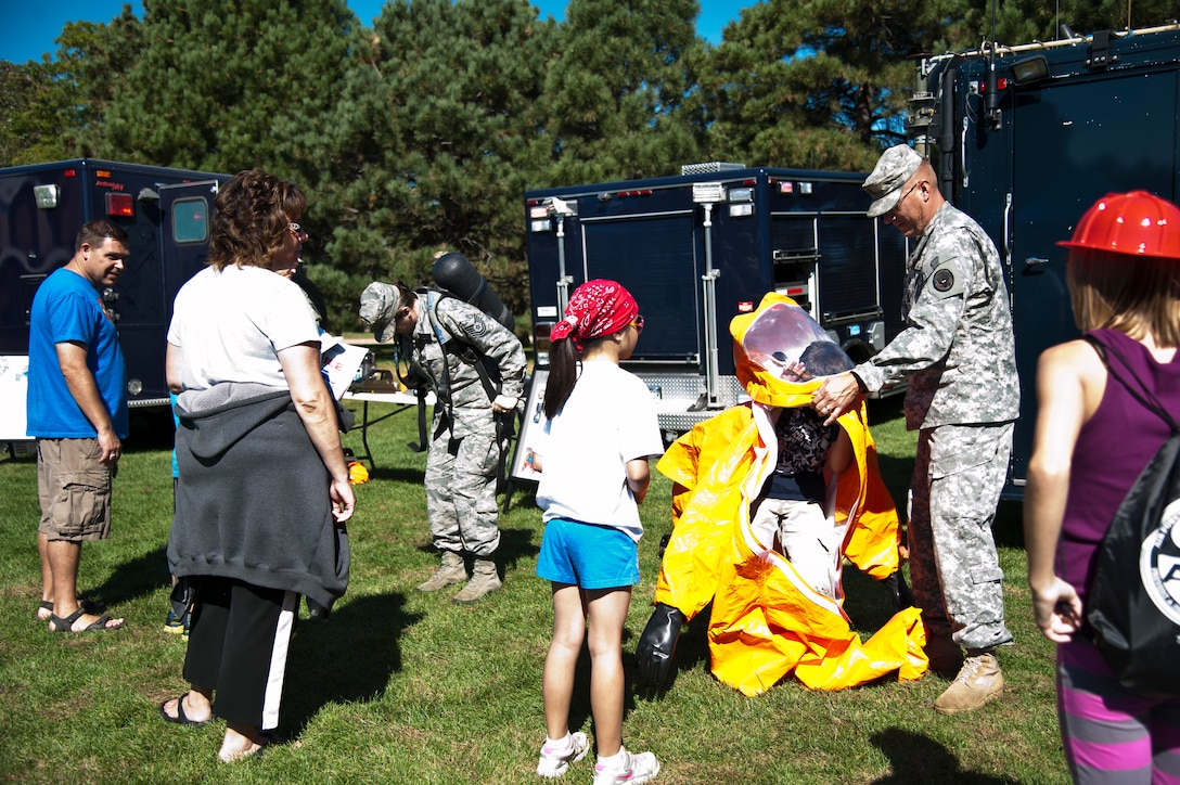 PETERSON AIR FORCE BASE, Colo. – Members of Colorado National Guard demonstrate equipment used in the event of a chemical, biological, radiological or nuclear disaster at Nickelodeon's Worldwide Day of Play at Patriot Park, Sept. 26, 2015. The annual event included a Color Run, a healthy cooking challenge, inflatable obstacle courses, climbing wall, games, snacks, and demonstrations from the Peterson Fire Station and Mobile Emergency Operations Center. (U.S. Air Force photo by Senior Airman Tiffany DeNault)