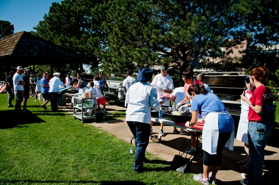 """PETERSON AIR FORCE BASE, Colo. – Nickelodeon's Worldwide Day of Play attendees participate in a cook off challenge at Patriot Park, Sept. 26, 2015. The participants were handed a """"basket"""" of ingredients and were given 70 minutes to create a meal to be judged. The cook-off challenge was one of many events at the Worldwide Day of Play; including a pet microchipping station, demonstrations by the Colorado National Guard, Peterson Fire Station and Peterson's Mobile Emergency Operations Center. (U.S. Air Force photo by Senior Airman Tiffany DeNault)"""
