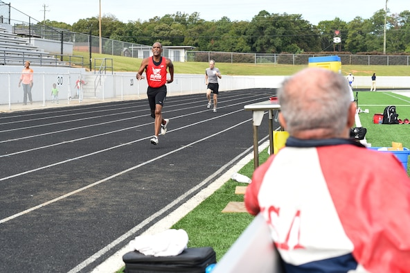 Frank Lathron, an 82-year-old senior olympian, watches his fellow competitors' race in the 400-meter run during the Georgia Golden Olympics Sept. 17, 2015, in Warner Robins, Ga. Lathron sustained an injury during his first run of the day, but stayed to cheer on his fellow competitors. (U.S. Air Force photo by Senior Airman Ceaira Tinsley/ Released)
