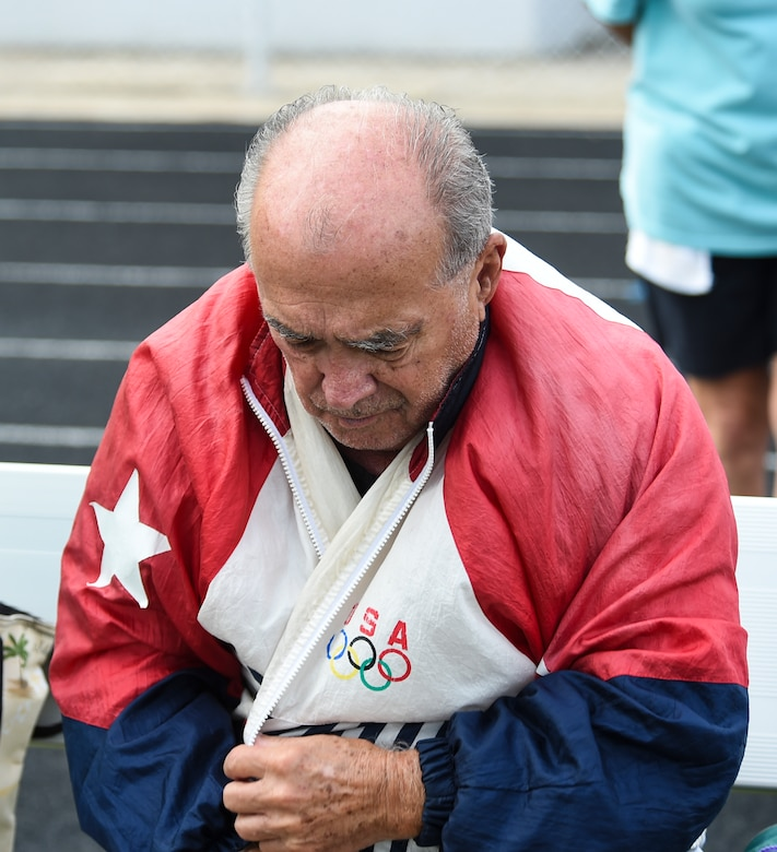 Frank Lathron, an 82-year-old senior olympian, reflects on the events of the day during the Georgia Golden Olympics Sept. 17, 2015, in Warner Robins, Ga. Lathron signed up to compete in the 50, 100, and 200-meter runs, but sustained a leg injury that eliminated him from the competition. (U.S. Air Force photo by Senior Airman Ceaira Tinsley/ Released)