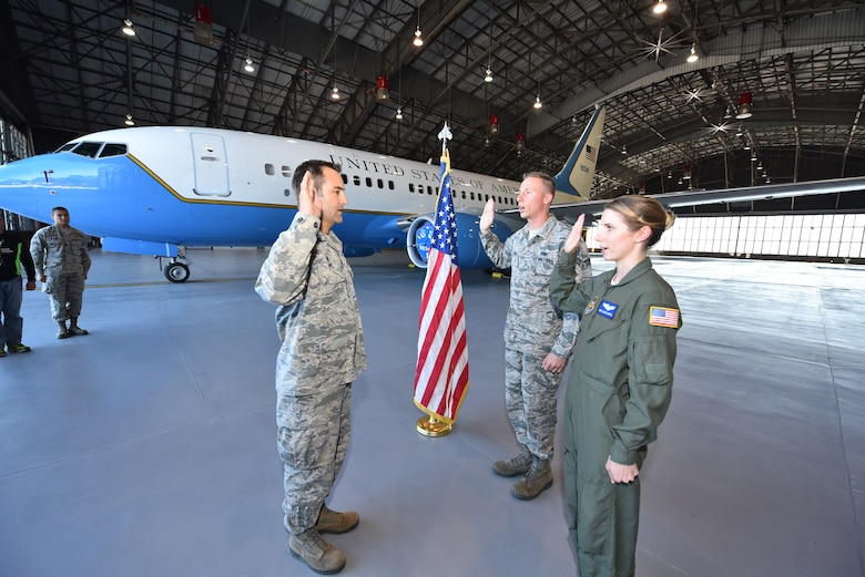 Lt. Col. Troy Appel performs the oath of enlistment again with Staff Sgt. Marie Carroll, 932nd Aeromedical Evacuation Squadron medical technician, and her brother Senior Airman Damien Ford from the 932nd Maintenance Squadron inside Hangar 1 at Scott Air Force Base, Illinois.  The siblings were choosing to continue on in the Air Force Reserve and were also interviewed as part of a video highlighting family members assigned to the 932nd Airlift Wing. To view the full video, check us out on Facebook at www.facebook.com/932ndAirliftWing or YouTube at https://www.youtube.com/user/932ndAW. (U.S. Air Force photo by Christopher Parr)