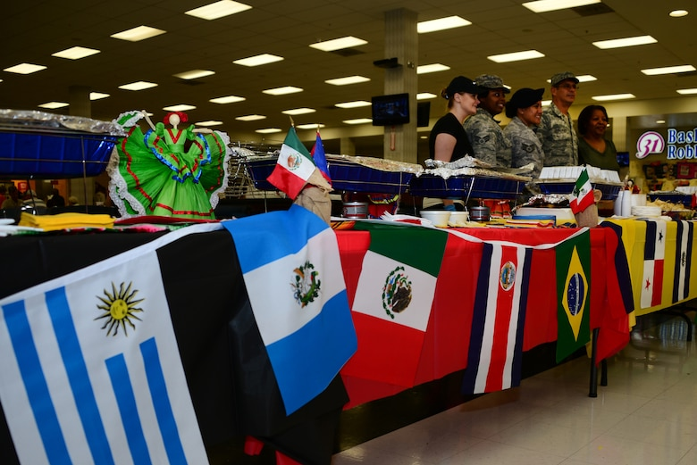 Members of the Hispanic Heritage Committee and volunteers prepare to serve food during Hispanic Heritage Month by hosting a food tasting at Davis-Monthan Air Force Base, Ariz., Sept. 22, 2015. The observance for HHM is from Sept. 15 to Oct. 15, while the committee will be hosting events for Desert Lightning Team members. (U.S. Air Force photo by Airman 1st Class Mya M. Crosby/Released)