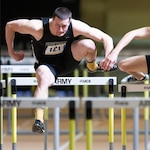 Cadet, now 1st Lt., Kyler Martin runs the 60-meter hurdles during an Army-Navy meet at the U.S Military Academy, West Point, N.Y., 2013.
