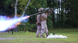 A Marine fires an FIM-92 Stinger Missile at a target during a stinger simulation training range at Marine Corps Air Station Cherry Point, North Carolina, Sept. 24, 2015. Marines with 2nd Low Altitude Air Defense Battalion sharpened their proficiency skills by simulating the weight transfer felt when firing the 34.2 pound missile. The weapon is a personal and portable infrared, homing, surface-to-air missile capable of tracking and engaging aircraft up to an altitude of 10,000 feet and covering distances up to eight kilometers. 2nd LAAD utilizes the stinger missile to provide ground-to-air defense to the 2nd Marine Aircraft Wing and Marine Air-Ground Task Force elements.