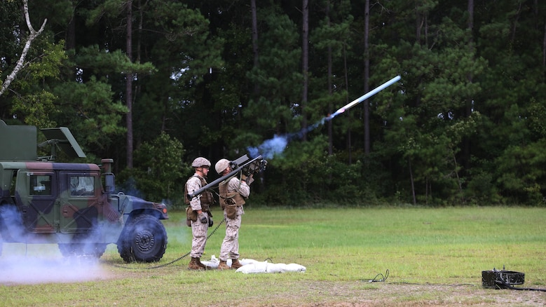 A Marine fires a dummy round into the air during a stinger simulation training range at Marine Corps Air Station Cherry Point, North Carolina, Sept. 24, 2015. Marines with 2nd Low Altitude Air Defense Battalion sharpened their proficiency skills by simulating the weight transfer felt when firing the 34.2 pound missile. The weapon is a personal and portable infrared, homing, surface-to-air missile capable of tracking and engaging aircraft up to an altitude of 10,000 feet and covering distances up to eight kilometers. 2nd LAAD utilizes the stinger missile to provide ground-to-air defense to the 2nd Marine Aircraft Wing and Marine Air-Ground Task Force elements.
