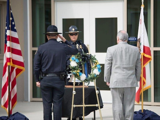 DLA Installation Support San Joaquin police chief John Vieira and site director Jonathan Mathews lay the wreath at the base of the ceremonial bell in honor of law enforcement officers killed in the line of duty.
