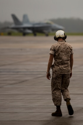 A Marine stands on the flight line aboard Marine Corps Air Station Beaufort awaiting the arrival of Marine Fighter Attack Training Squadron 101 Sept. 24. VMFAT-101 will be in Beaufort for three weeks conducting training. The Marine is with Marine All Weather fighter Attack Squadron 533, Marine Aircraft Group 31.
