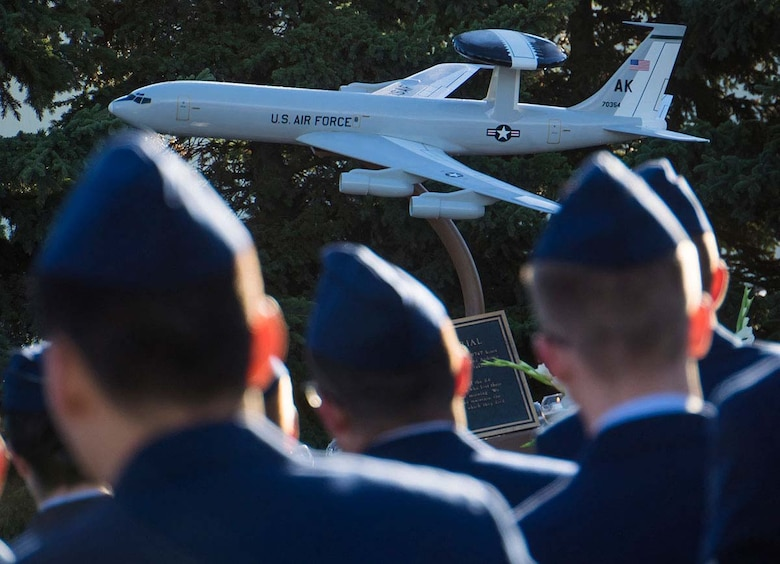 American and Canadian airmen assigned to the 962nd Airborne Air Control Squadron, distinguished guests, and surviving family members of the crew of the E-3B Sentry, AWACS aircraft, call sign Yukla 27, gathered for 20th anniversary memorial ceremonies on Joint Base Elmendorf-Richardson, Alaska, Sept. 22, 2015. Yukla 27, from the 962nd AACS, encountered a flock of geese Sept. 22, 1995, and crashed shortly after takeoff on a routine surveillance training sortie, killing all 24 U.S. and Canadian airmen aboard. (U.S. Air Force photo/Justin Connaher)
