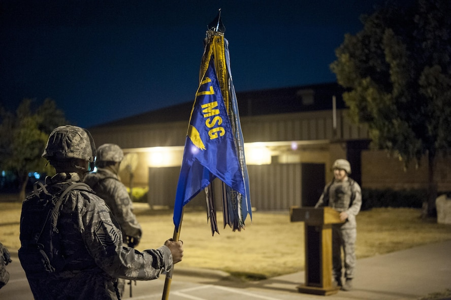 U.S. Air Force Master Sgt. Steven D. Thompson, 17th Security Forces Squadron first sergeant, holds the 17th Mission Support Group guidon during the 10th Annual Airman 1st Class Jacobson Memorial Ruck March opening ceremony at the 17th SFS building Sept. 28, 2015. The march was in honor of security forces member Airman 1st Class Elizabeth Jacobson, and marked the 10th anniversary of her death. Jacobson was the first security forces member as well as the first Air Force female to be killed in action in Operation Iraqi Freedom, in 2005, by a roadside bomb. (U.S. Air Force photo by Staff Sgt. Michael Smith/Released)