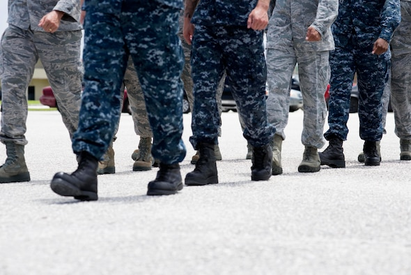 Airman Leadership School Class 15-F students participate in a drill exercise Aug. 18, 2015, at Andersen Air Force Base, Guam. ALS is a five-week course that prepares senior airmen, new staff sergeants and sister service rank equivalents for official supervisory and rating duties. (U.S. Air Force photo by Senior Airman Katrina M. Brisbin/Released)