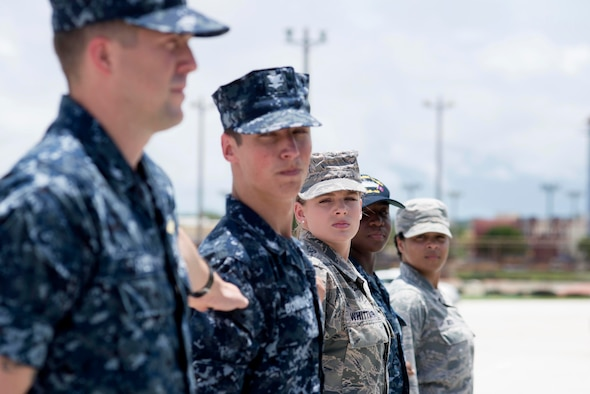 Airman Leadership School Class 15-F students participate in a drill exercise Aug. 18, 2015, at Andersen Air Force Base, Guam. ALS, a 192-hour course, spread across 24 days, is divided into three major academic curriculum areas that focus on developing leadership abilities, building effective communication and the profession of arms. (U.S. Air Force photo by Senior Airman Katrina M. Brisbin/Released)