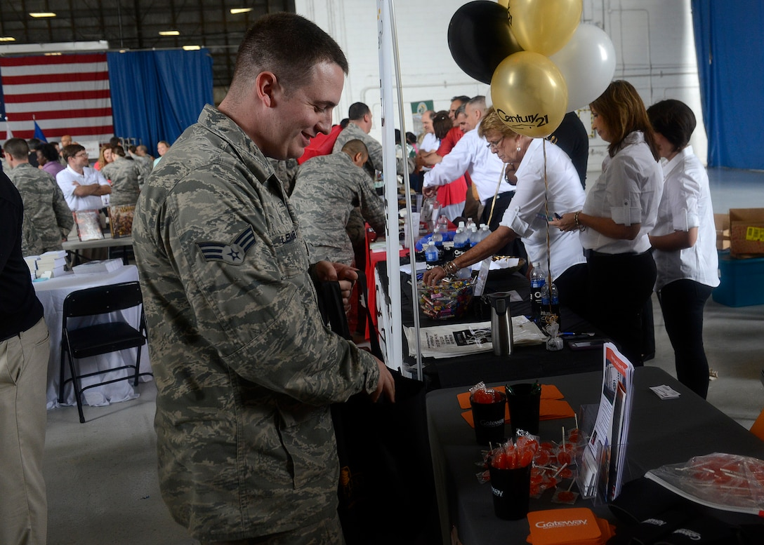 Senior Airman Matthew Lemmer, 20th Communication Squadron radio frequency transmission system technician, visits a booth during the 7th Annual Military Appreciation Picnic at Shaw Air Force Base, S.C., Sept. 25, 2015. Various community businesses came out to show their support and provide information about their businesses throughout the event. (U.S. Air Force photo by Airman 1st Class Christopher Maldonado/Released)