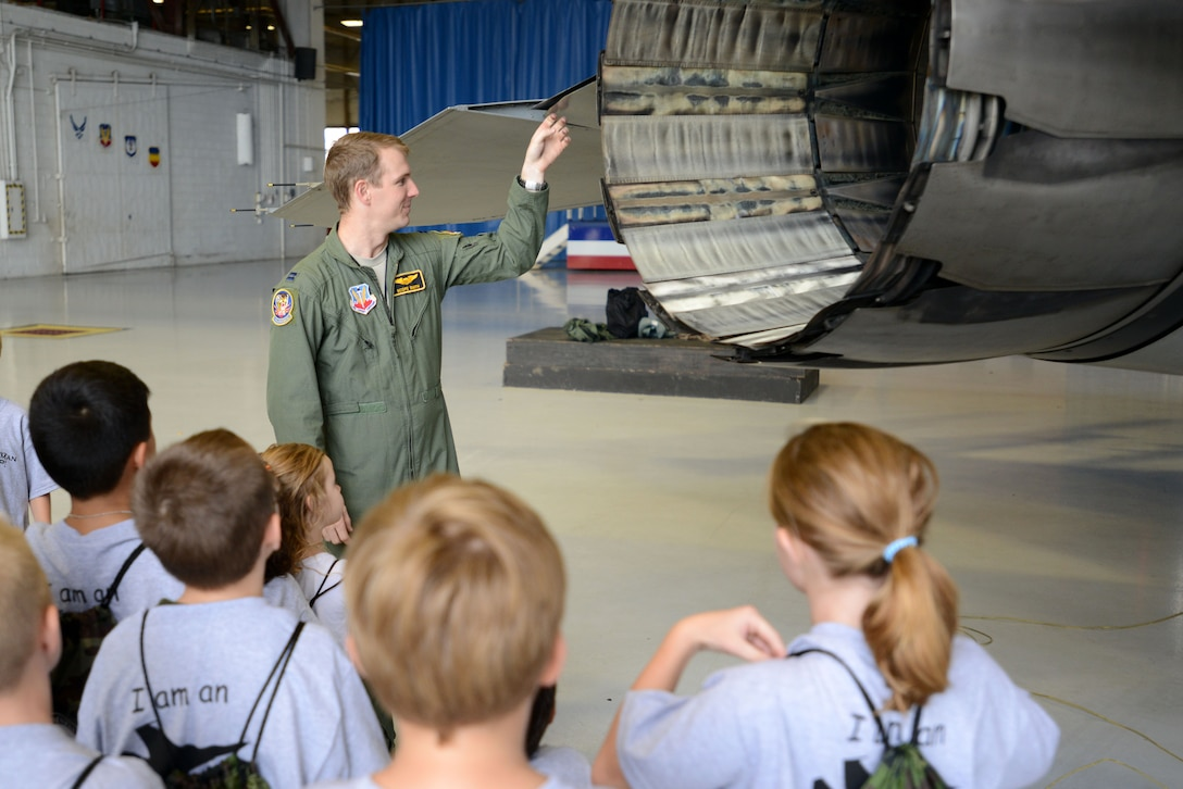 U.S. Air Force Capt. Kirk Smith, 79th Fighter Squadron pilot, explains the functions of different parts of an F-16CM Fighting Falcon to a crowd of children during the Kids Meet the Viper event at Shaw Air Force Base, S.C., Sept. 23, 2015. The event was held to educate military children about deployments and what their parents may experience when they have to leave home. (U.S. Air Force photo by Airman 1st Class Kelsey Tucker/Released)