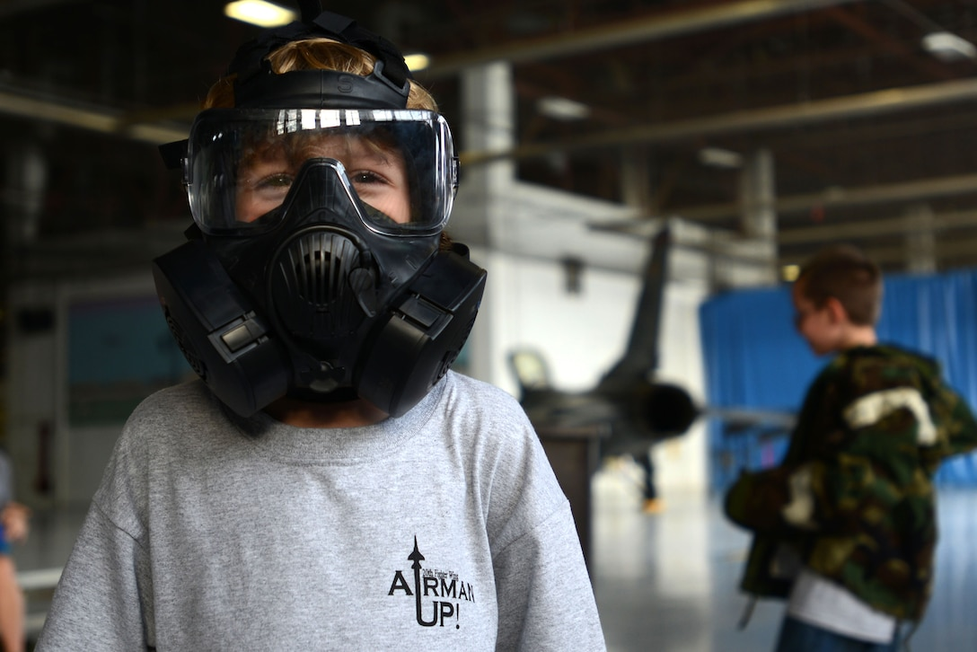 A Team Shaw child tries on a gas mask during the Kids Meet the Viper event at Shaw Air Force Base, S.C., Sept. 23, 2015. The gas mask is part of the Mission Oriented Protective Posture gear issued to Airmen, which would be used in the event of chemical, biological, radiological, or nuclear threats. (U.S. Air Force photo by Airman 1st Class Kelsey Tucker/Released)