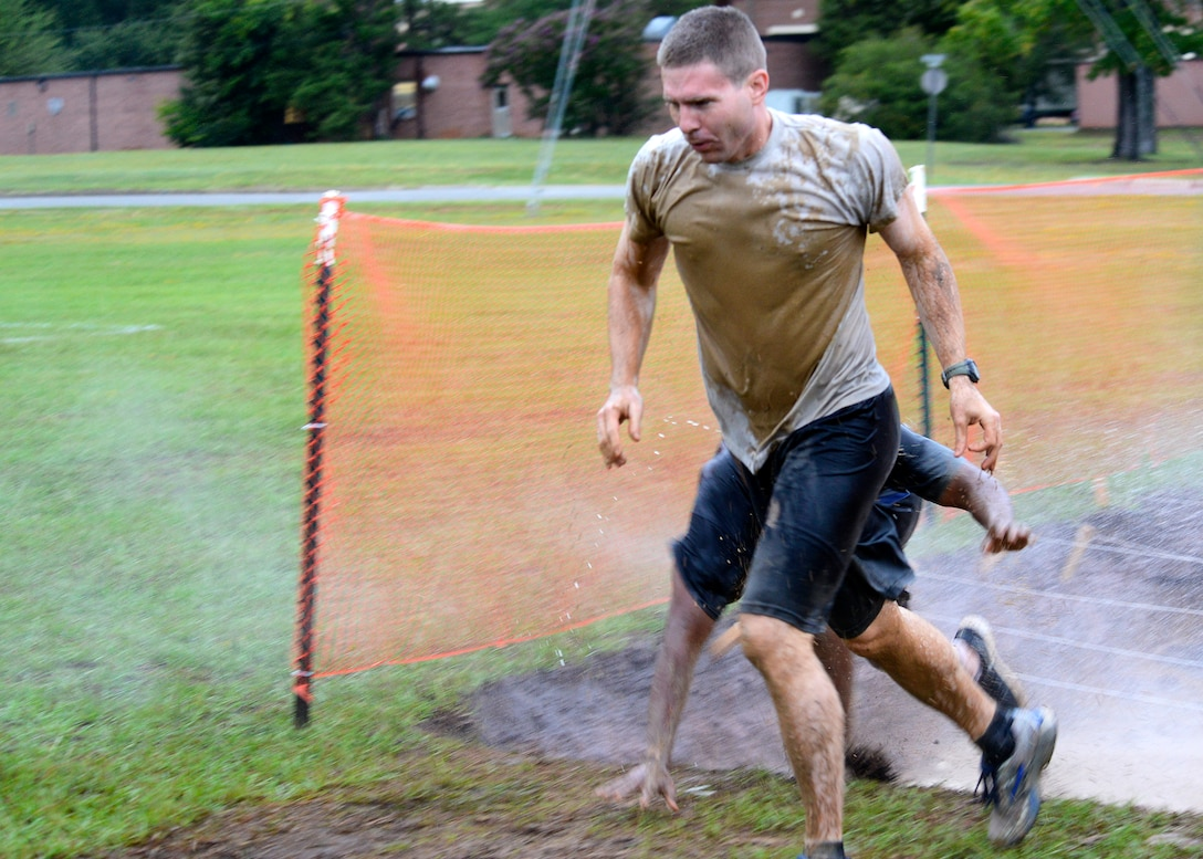 U.S. Air Force Airmen finishes the trench obstacle and prepares to take on the next obstacle during a 20th Fighter Wing Comprehensive Airmen Fitness obstacle course at Shaw Air Force Base, S.C., Sept. 25, 2015.  Airmen had to complete a total of eight obstacles, with varying difficulties and terrain conditions. (U.S. Air Force photo by Airman 1st Class Christopher Maldonado/Released)