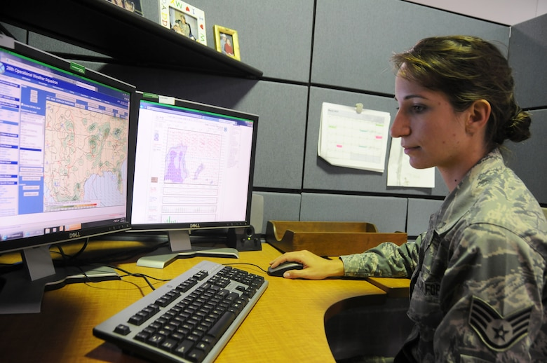 Staff Sgt. Jennifer Burgos, weather forecast apprentice, analyzes satellite and radar data June 6, 2015 during the approach of Tropical Depression Bill at Ebbing Air National Guard Base, Fort Smith, Ark. Weather forecasters analyze weather conditions, prepare forecasts, issue weather warnings and brief weather information to pilots. (U.S. Air National Guard photo by Senior Airman Cody Martin/Released)