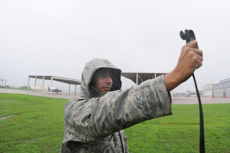 Tech. Sgt. Joseph Williams, weather forecaster, uses the Kestrel 4500NV pocket weather tracker at Ebbing Air National Guard Base, Fort Smith, Ark., to measure wind, temperature, dew point and other atmospheric elements of Tropical Storm Bill June 6, 2015. Weather forecasters analyze weather conditions, prepare forecasts, issue weather warnings and brief weather information to pilots. (U.S. Air National Guard photo by Senior Airman Cody Martin/Released)