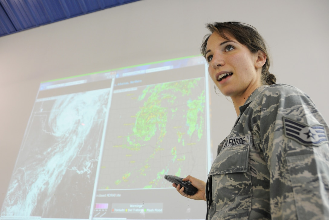 Staff Sgt. Jennifer Burgos, weather forecast apprentice, explains the effects of Tropical Depression Bill June 18, 2015, during a presentation provided at Ebbing Air National Guard Base, Fort Smith, Ark. Weather forecasters analyze weather conditions, prepare forecasts, issue weather warnings and brief weather information to pilots. (U.S. Air National Guard photo by Senior Airman Cody Martin/Released)