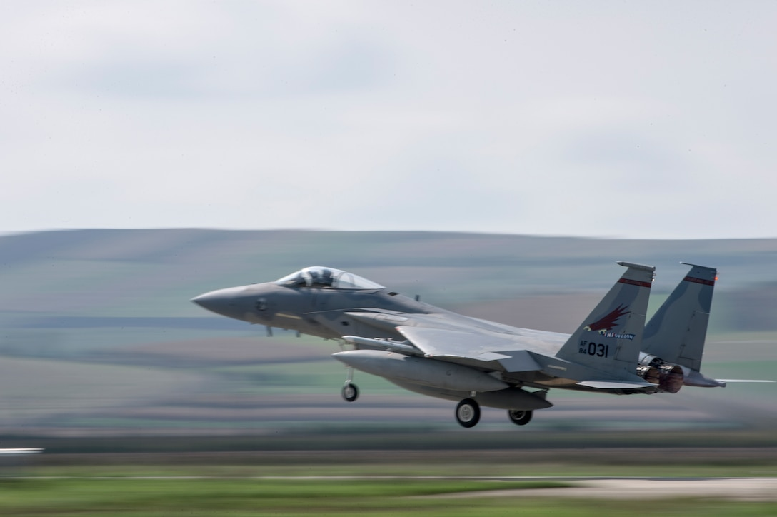 An F-15C Eagle fighter aircraft assigned to the 123rd Expeditionary Fighter Squadron, 142nd Fighter Wing, Oregon Air National Guard, takes off from the runway during a theater security package deployment Sept. 25, 2015, at Campia Turzii, Romania. The first TSP concludes with the departure of the 123rd EFS but a constant presence remains in Europe with the arrival of U.S. Air Force A-10C Thunderbolt IIs attack aircraft from the 74th Expeditionary Fighter Squadron, 23rd Wing at Moody Air Force Base, Ga. (U.S. Air Force photo by Staff Sgt. Christopher Ruano/Released)
