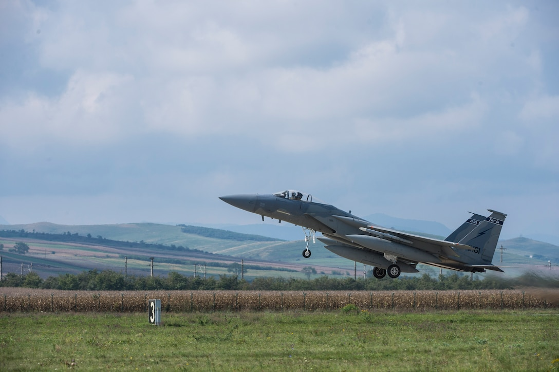 An F-15C Eagle fighter aircraft pilot assigned to the 123rd Expeditionary Fighter Squadron, 142nd Fighter Wing, Oregon Air National Guard, takes off during a theater security package deployment Sept. 25, 2015, at Campia Turzii, Romania. These deployments send a clear message to the international community that the U.S. is serious about security and stability in the region. (U.S. Air Force photo by Staff Sgt. Christopher Ruano/Released)