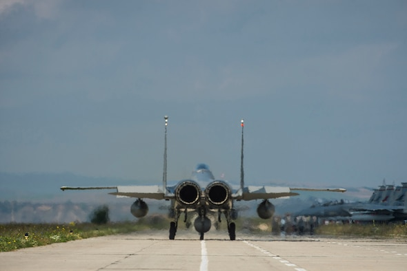 An F-15C Eagle fighter aircraft pilot assigned to the 123rd Expeditionary Fighter Squadron, 142nd Fighter Wing, Oregon Air National Guard, taxis during a theater security package deployment Sept. 25, 2015, at Campia Turzii, Romania. U.S. and Romanian air forces conducted training aimed at strengthening interoperability and demonstrated the countries' shared commitment to the security and stability of Europe. (U.S. Air Force photo by Staff Sgt. Christopher Ruano/Released)