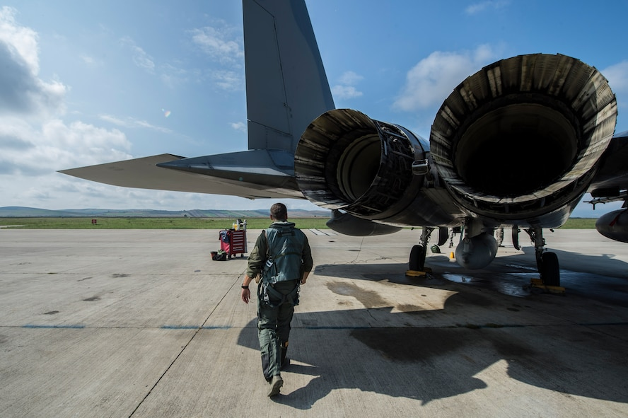 An F-15C Eagle fighter aircraft pilot assigned to the 123rd Expeditionary Fighter Squadron, 142nd Fighter Wing, Oregon Air National Guard, does a walk around his aircraft during a theater security package deployment Sept. 25, 2015, at Campia Turzii, Romania. The aircraft deployed to Romania in support of Operation Atlantic Resolve to bolster air power capabilities while underscoring the U.S. commitment to European security and stability. (U.S. Air Force photo by Staff Sgt. Christopher Ruano/Released)