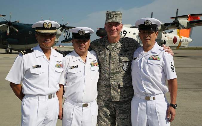 Japan Maritime Self-Defense Force Warrant Officer Ootaki Fumio, first, JMSDF Chief Petty Officer Yukihiro Kamouchi, second, U.S. Air Force Lt. Gen. John L. Dolan, commander of U.S. Forces Japan and 5th Air Force, third, and JMSDF Chief Petty Officer Noriaki Tazaki, fourth, pose at the JMSDF hangar at Marine Corps Air Station Iwakuni, Japan, Sept. 23, 2015. During a visit to the installation, Dolan took time to reconnect with the JMSDF members who saved his life over two decades ago when he was forced to eject from his aircraft 630 nautical miles from Tokyo into the Pacific Ocean.