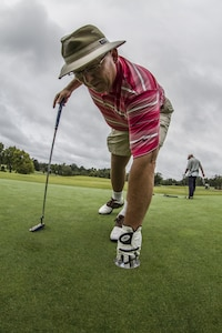 Barry Moore, 108th Training Command (IET) supervisory logistics management specialist, is finally given the opportunity to retrieve his golf ball, while participating in the 5th annual Griffon Association golf tournament at the Pine Island Country Club, in Charlotte, N.C., Sept. 28, 2015. More than 50 Soldiers, veterans and family members participated in the event to raise money for educational scholarships and charity. (U.S. Army photo by Sgt. 1st Class Brian Hamilton)
