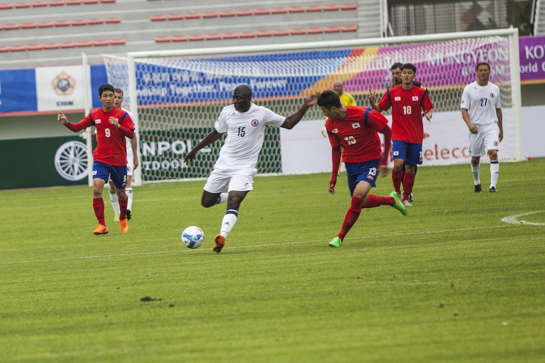 U.S. men's soccer team player Adrian Brown, center, steals the ball from South Korean men's soccer player Oh Kyu Kim during the first round of the 6th CISM Military World Games in Mungyeong, South Korea, Sept. 30, 2015. U.S. Marine Corps photo by Sgt. Ashley Cano